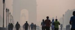 People walking in Dehli experiencing strongAir Pollution