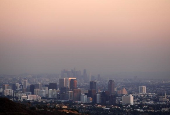 A view of a city skyline with a heavy layer of smog