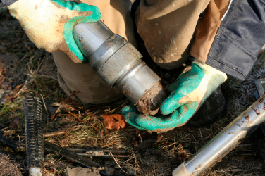 An environmental Engineer takes a soil sample